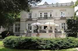 A man works in the garden of a high-end restaurant, Amber Room, July 12, 2019, where top Polish politicians and business people were secretly and illegally recorded over hundreds of hours in 2013 and 2014, in Warsaw, Poland.