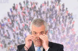 FILE - Calin Popescu Tariceanu, leader of Alliance of Liberals and Democrats and head of Romania's Senate during a press conference in Bucharest, Romania, July 24, 2019.