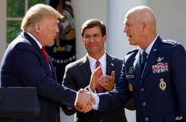 """President Donald Trump, joined by Secretary of Defense Mark Esper, shakes hands with Gen. John """"Jay"""" Raymond during a ceremony to establish the U.S. Space Command in the Rose Garden of the White House in Washington, Aug. 29, 2019."""