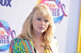 Taylor Swift arrives at the Teen Choice Awards, Aug. 11, 2019, in Hermosa Beach, California.