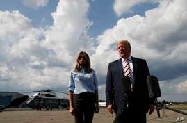 President Donald Trump, with first lady Melania Trump, speaks to the media about the recent mass shootings in El Paso, Texas, and Dayton, Ohio, before boarding Air Force One in Morristown, New Jersey, Aug. 4, 2019, to return to Washington.