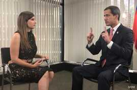 Venezuelan opposition leader Juan Guaido is interviewed by VOA Spanish reporter Adriana Nunez Rabascal, in Caracas, Venezuela, Aug. 19, 2019.