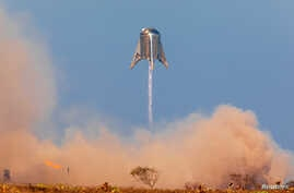 "SpaceX's Mars Starship prototype ""Starhopper"" hovers over its launchpad during a test flight in Boca Chica, Texas, Aug. 27, 2019."