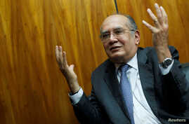 FILE - Judge Gilmar Mendes gestures during an interview with Reuters in Brasilia, Brazil, Aug. 22, 2019.