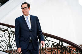 U.S. Treasury Secretary Steven Mnuchin walks to a working breakfast at the G7 Summit in Biarritz, France, Aug. 25, 2019.