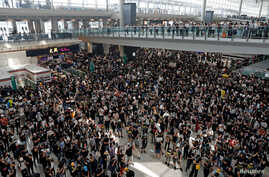 Anti-extradition bill protesters attend a mass demonstration at Hong Kong International Airport, Aug. 12, 2019.