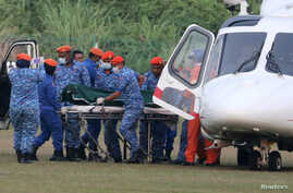 A body believed to be 15-year-old Irish girl Nora Anne Quoirin who went missing is brought out of a helicopter in Seremban, Malaysia, Aug. 13, 2019.