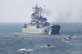 An amphibious assault ship and armored personnel carriers are seen during military exercises on the Baltic Sea coast in Kaliningrad Region, Russia, April 4, 2019.