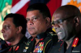 FILE - Chief of staff of Sri Lankan army Shavendra Silva attends a news conference in Colombo, Sri Lanka, May 16, 2019.