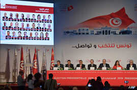 Members of the Independent Higher Authority for Elections (ISIE) announce the official results of the presidential election during a press conference in Tunisia's capital, Tunis, Sept. 17, 2019.