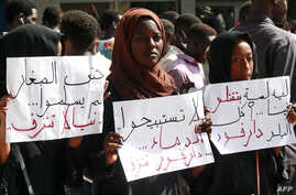People demonstrate against the way police handled a student protest over a shortage of bread in Darfur's state capital Nyala the previous day, in Khartoum, Sept. 23, 2019.