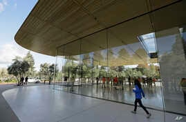 FILE - An exterior view of the Apple Park Visitor Center during its grand opening in Cupertino, Calif.