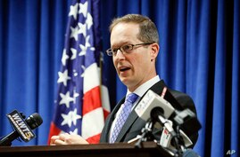 FILE - U.S. Attorney Benjamin Glassman speaks during a news conference in Cincinnati, Oct. 10, 2018.