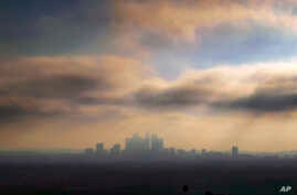 FILE - In this Oct. 26, 2018, file photo, downtown Los Angeles is shrouded in early morning coastal fog and smog.