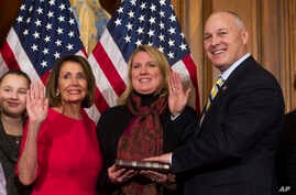 House Speaker Nancy Pelosi of Calif., right, poses during a ceremonial swearing-in with Rep. Pete Stauber, R-Minn., on Capitol Hill in Washington, Jan. 3, 2019, during the opening session of the 116th Congress.