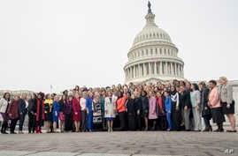 Members of the 116th Congress pose for a group photo on Capitol Hill in Washington, Friday, Jan. 4, 2019.