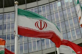 The Iranian flag waves outside of the UN building that hosts the International Atomic Energy Agency, IAEA, office inside in Vienna, Austria, July 10, 2019.