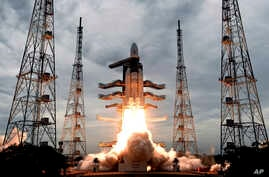 FILE - This photo released by the Indian Space Research Organization shows its Geosynchronous Satellite Launch Vehicle MkIII, carrying Chandrayaan-2, lift off from Satish Dhawan Space center in Sriharikota, India, July 22, 2019.