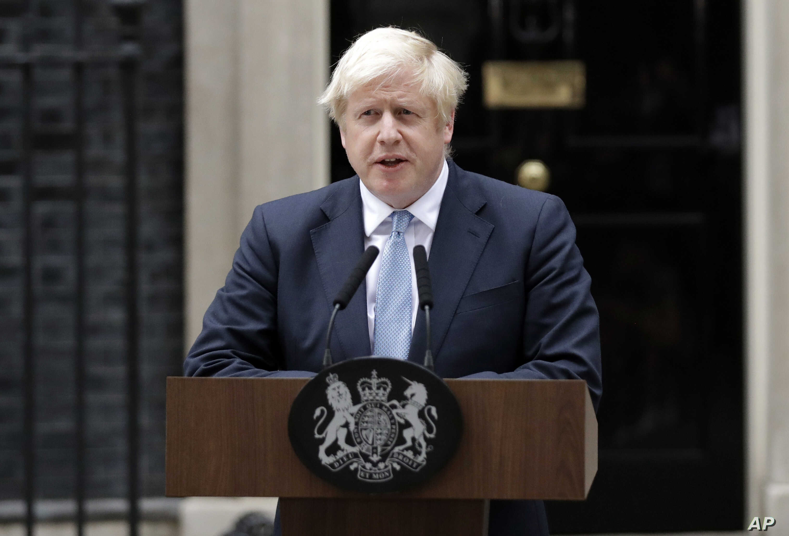 Britain's Prime Minister Boris Johnson speaks to the media outside 10 Downing Street in London, Sept. 2, 2019. Johnson says chances of a Brexit deal are rising .