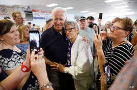 Democratic presidential candidate former Vice President Joe Biden gets a hug from Ruth Nowadzky, of Cedar Rapids, Iowa, during the Hawkeye Area Labor Council Labor Day Picnic in Cedar Rapids, Iowa, Sept. 2, 2019.