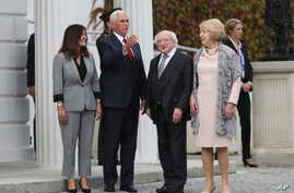 US Vice President Mike Pence and wife Karen Pence, left, meet with Irish President Michael D Higgins and his wife Sabrina at Aras an Uachtarain the official residence of the Irish President , Dublin, Ireland, Sept. 3, 2019.
