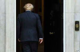 Britain's Prime Minister Boris Johnson walks back into 10 Downing Street after greeting US Vice President Mike Pence in London, Sept. 5, 2019.