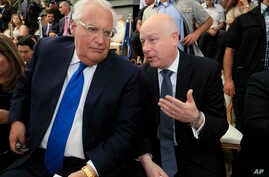 In this June 30, 2019 file photo, U.S. Ambassador to Israel David Friedman, left, and White House Mideast envoy Jason Greenblatt attend the opening of an ancient road at the City of David, a popular archaeological and tourist site.