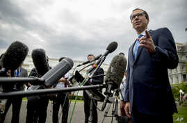 Treasury Secretary Steve Mnuchin takes a question from a reporter outside the West Wing of the White House in Washington, Sept. 9, 2019.