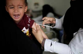 A boy reacts as he receives a diphtheria vaccine at a hospital in Sanaa, Yemen, Sept. 9, 2019.