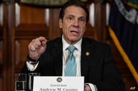 FILE - New York Gov. Andrew Cuomo, seen in this Jan. 2019 file photo, says he's directing state health officials to ban the sale of flavored e-cigarettes, citing the risk of young people getting addicted to nicotine, Jan. 29, 2019.
