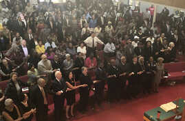 """Presidential candidate and former Vice President Joe Biden, left front, joins the congregation of 16th Street Baptist Church in Birmingham, Alabama, as they sing """"We Shall Overcome"""" at Sunday worship on Sept. 15, 2019."""