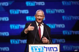 Blue and White party leader Benny Gantz addressees his supporters at party headquarters after the first results of the elections in Tel Aviv, Israel, Wednesday, Sept. 18, 2019.