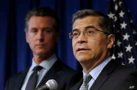 California AG  Xavier Becerra, right, flanked by Gov. Gavin Newsom, discusses the Trump administration's pledge to revoke California's authority to set vehicle emissions standards.