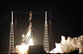 FILE - A Falcon 9 SpaceX rocket, with a payload of 60 satellites for SpaceX's Starlink broadband network, lifts off from Space Launch Complex 40 at the Cape Canaveral Air Force Station in Cape Canaveral, Florida, May 23, 2019.