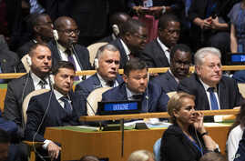 Delegates from the Ukraine listens as U.S.President Donald Trump addresses the 74th session of the United Nations General Assembly at U.N. headquarters, Sept. 24, 2019.