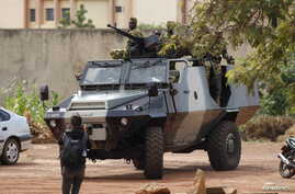 Presidential guard soldiers are seen on an armored vehicle at Laico hotel in Ouagadougou, Burkina Faso, September 20, 2015.