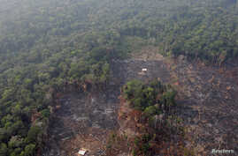 FILE - An aerial view shows a deforested plot of the Amazon near Humaita, Amazonas State, Brazil, Aug. 22, 2019.