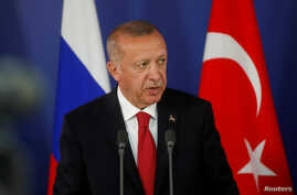 FILE - Turkish President Recep Tayyip Erdogan attends a news conference in Moscow, Russia, Aug. 27, 2019.