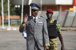 FILE - Burkina Faso's coup leader General Gilbert Diendere arrives at the airport to greet foreign heads of state in Ouagadougou, Burkina Faso, Sept. 23, 2015.