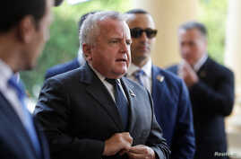 FILE - U.S. Deputy Secretary of State John J. Sullivan arrives at the Lopez Palace in Asuncion, Paraguay, Sept. 6, 2019.