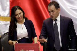 Mexico's Finance Minister Arturo Herrera presents the 2020 national budget to Laura Angelica Rojas, president of the Lower House of Congress, at the Congress building in Mexico City, Mexico, Sept. 8, 2019.
