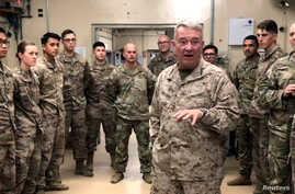 Marine General Kenneth McKenzie, head of U.S. Central Command, speaks with U.S. troops while visiting Forward Operating Base Fenty in Jalalabad, Afghanistan, Sept. 9, 2019.