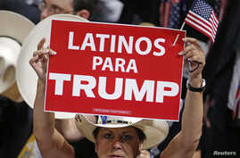 "A woman holds a sign reading in English, ""Latinos For Trump"" at the Republican National Convention in Cleveland, Ohio."