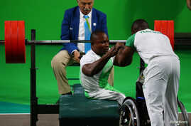 FILE - Roland Ezuruike of Nigeria reacts during the men's Paralympic Powerlifting competition, Rio de Janeiro, Brazil, Sept. 9, 2016.