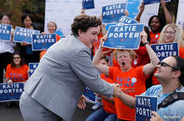 FILE - Democratic congressional candidate Katie Porter, running in 45th Congressional District, campaigns on the University of Irvine campus in Irvine, California.