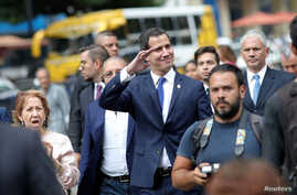 Venezuelan opposition leader Juan Guaido, who many nations have recognized as the country's rightful interim ruler, walks on the street after a gathering with supporters in Caracas, Sept. 19, 2019.