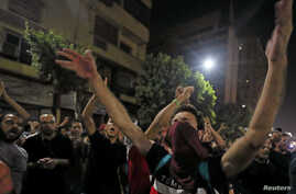 Small groups of protesters gather in central Cairo, shouting anti-government slogans in Cairo, Egypt, Sept. 21, 2019.