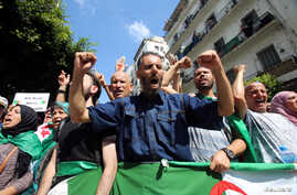 Demonstrators gesture and shout slogans during a protest demanding social and economic reforms, as well as the departure of the country's ruling elite in Algiers, Algeria, Sept. 24, 2019.