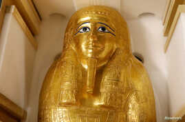 The gold coffin of Nedjemankh is displayed during a news conference to announce its return to the people of Egypt, in New York City, Sept. 25, 2019.