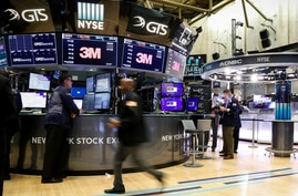FILE PHOTO: Traders work on the floor at the New York Stock Exchange in New York, Aug. 6, 2019.